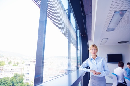 business woman  with her staff,  people group in background at modern bright office indoors Stock Photo - 16580553