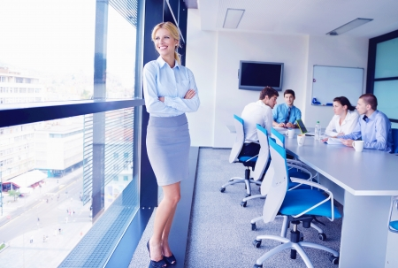 business woman  with her staff,  people group in background at modern bright office indoors Stock Photo - 16581362