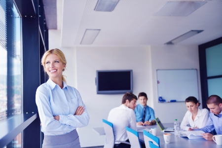 business woman  with her staff,  people group in background at modern bright office indoors Stock Photo - 16580991
