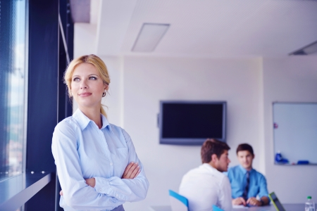 business woman  with her staff,  people group in background at modern bright office indoors Stock Photo - 16580843
