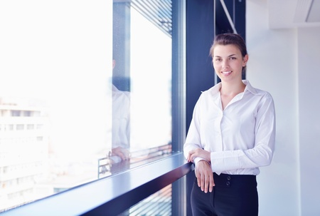 business woman  with her staff,  people group in background at modern bright office indoors Stock Photo - 16580286