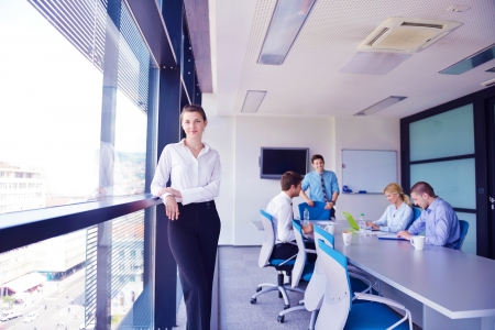 business woman  with her staff,  people group in background at modern bright office indoors Stock Photo - 16581256