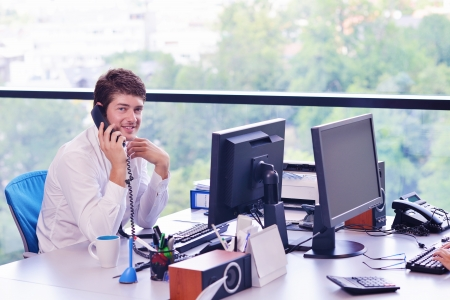 happy young business  man work in modern office on computer Stock Photo - 16581605