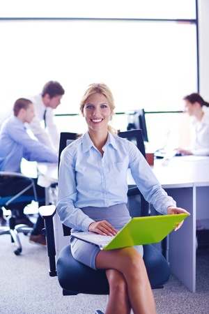 business woman  with her staff,  people group in background at modern bright office indoors Stock Photo - 16580981
