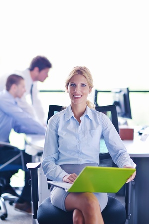 business woman  with her staff,  people group in background at modern bright office indoors Stock Photo - 16580538