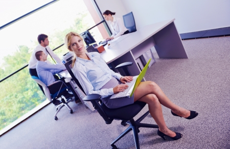 business woman  with her staff,  people group in background at modern bright office indoors Stock Photo - 16581675