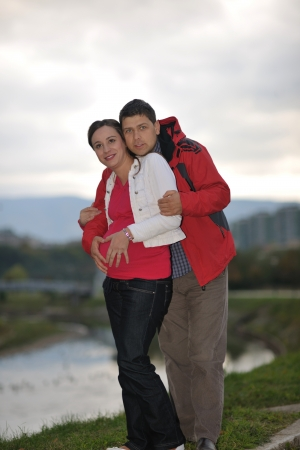 baby romantic: happy couple outdoor,  beautiful pregnant woman with her husband