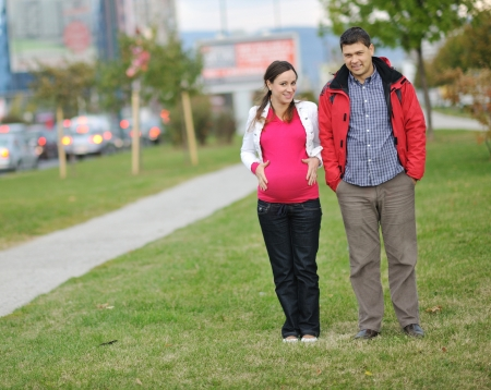 happy couple outdoor,  beautiful pregnant woman with her husband Stock Photo - 16596205