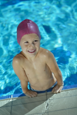 happy chid have fun on swimming pool photo