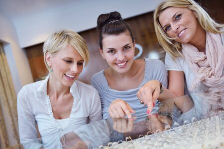 happy girls group  have fun while shopping in jewelry store photo