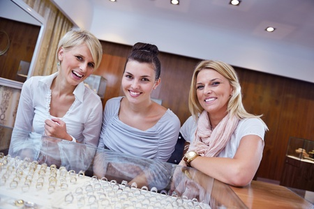 happy girls group  have fun while shopping in jewelry store Stock Photo - 16753962