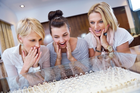 happy girls group  have fun while shopping in jewelry store Stock Photo - 16753953