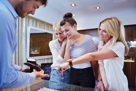 jewelry store: happy girls group  have fun while shopping in jewelry store Stock Photo