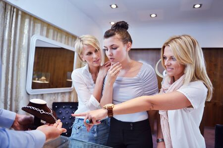 happy girls group  have fun while shopping in jewelry store Stock Photo - 16753961