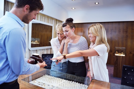 beauty shop: happy girls group  have fun while shopping in jewelry store Stock Photo