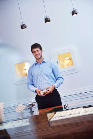 business man selling in jewelry store photo