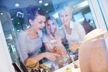 beauty store: happy girls group  have fun while shopping in jewelry store Stock Photo