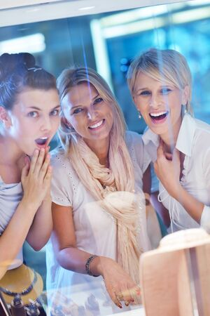 happy girls group  have fun while shopping in jewelry store Stock Photo - 16754048
