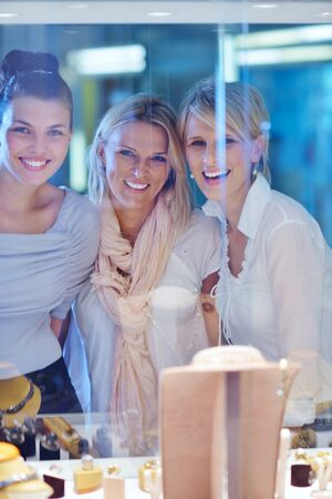 happy girls group  have fun while shopping in jewelry store Stock Photo - 16747894