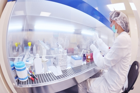 microbiology: group of scientists working at the laboratory