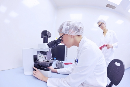 group of scientists working at the laboratory Stock Photo - 16885436