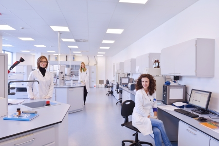 health care research: group of scientists working at the laboratory