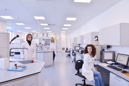 laboratory coat: group of scientists working at the laboratory