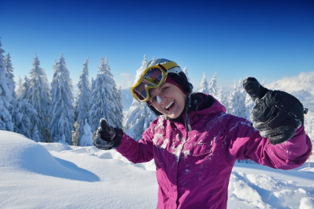 happy young ski woman at mountaint top on winter have fun photo