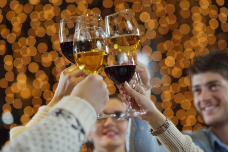 Celebration. Hands holding the glasses of champagne and wine making a toast. Stock Photo - 17057054