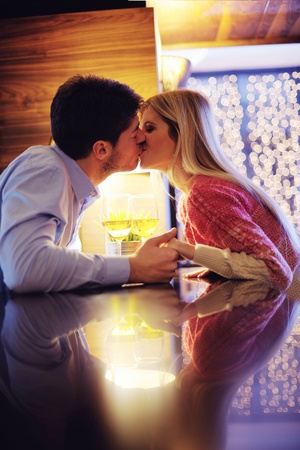 romantic evening date in restaurant  happy young couple with wine glass tea and cake Stock Photo - 17631010