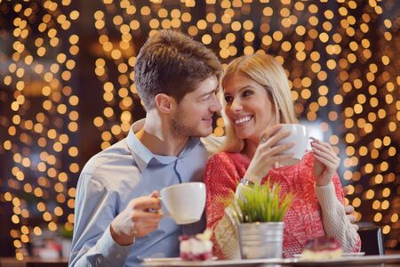 romantic evening date in restaurant  happy young couple with wine glass tea and cake Stock Photo - 17543193