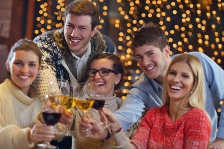 Group of happy young people drink wine at party disco restaurant Stock Photo - 17543238