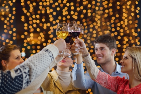 Group of happy young people drink wine at party disco restaurant Stock Photo - 17543298