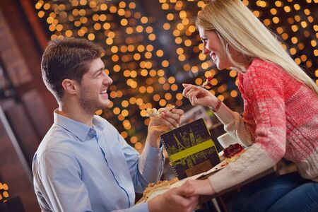 romantic evening date in restaurant  happy young couple with wine glass tea and cake Stock Photo - 17543196