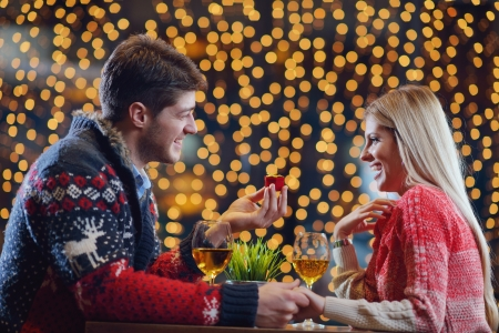 The young man gives a wedding ring   gift to  girl in restaurant Stock Photo - 17696342