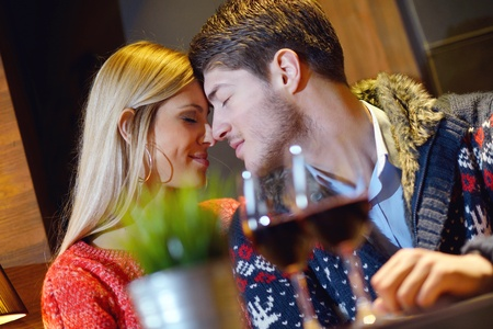 romantic evening date in restaurant  happy young couple with wine glass tea and cake Stock Photo - 17689384