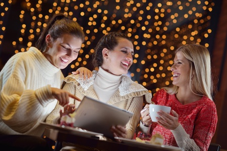 happy girls group  looking at a pc tablet in a home interior and have fun Stock Photo - 18740507