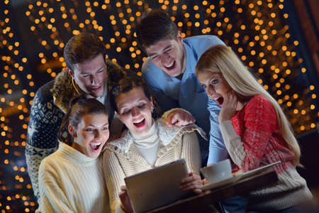 Group of happy people looking at a tablet computer photo