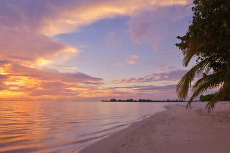 maldives island: beautiful tropical beach background landscape nature sunset Stock Photo