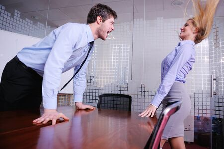 Angry business man screaming at employee in the office Stock Photo - 18186978