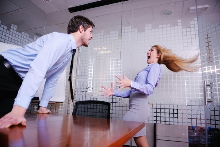 yell: Angry business man screaming at employee in the office Stock Photo