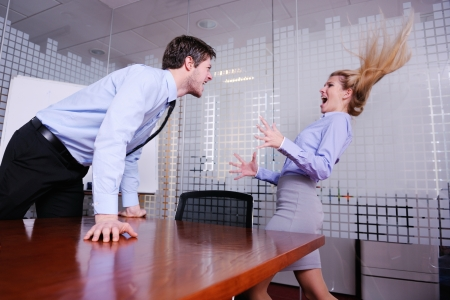 angry boss: Angry business man screaming at employee in the office Stock Photo