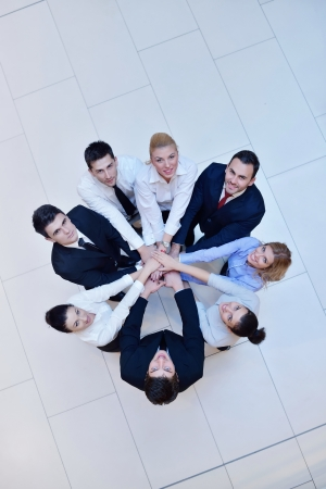 friendship circle: business people group joining hands and stay as team in circle  and representing concept of friendship and teamwork