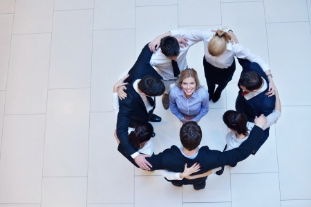 business people group joining hands and stay as team in circle  and representing concept of friendship and teamwork Stock Photo - 18175757
