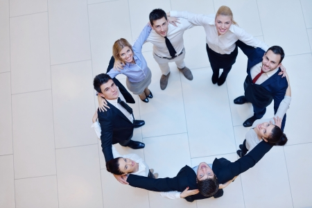 business people group joining hands and stay as team in circle  and representing concept of friendship and teamwork photo