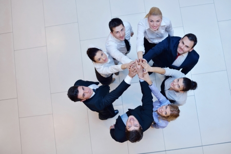 life support: business people group joining hands and stay as team in circle  and representing concept of friendship and teamwork