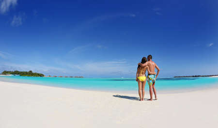 sexy love: happy young asian couple enjoying summer and have on beautiful white sand beach Stock Photo
