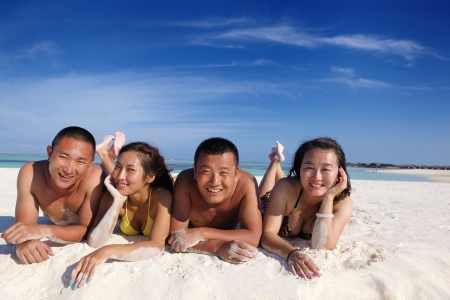 asian bikini: group of happy young people have fun and joy at the  white sand  beach on beautiful summer  day