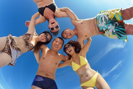 group of happy young people have fun and joy at the  white sand  beach on beautiful summer  day Stock Photo - 18320107