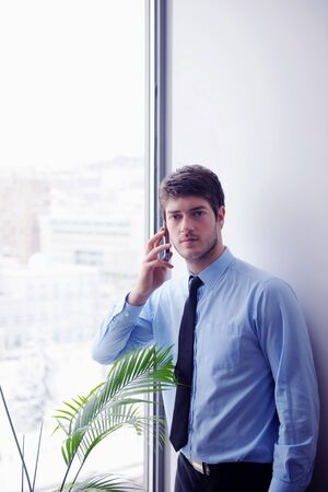 business man talking by cellphone in office photo